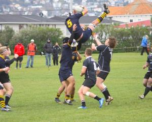 Dunedin lock Richard Thompson looses the support of his lifters while the Pirates forwards...