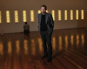 Dunedin Public Art Gallery curator Aaron Kreisler stands amid  the 'Te Po' exhibition while ...