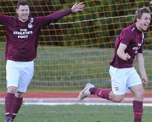 Dunedin Technical player-coach Aaron Burgess (left) and Dave Hayman celebrate Hayman's goal in...