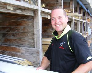 Knowledge and experience: Dunedin Timber Market manager Jared Greaves helps a customer with a...