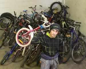 Dunedin Training Centre trainee Zane Grant (17) moves the consignment of Christchurch bikes...