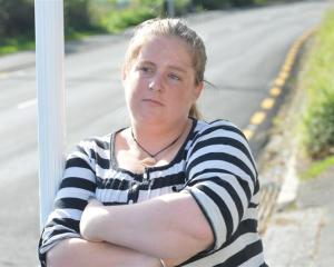 Dunedin woman Lisa Brett reflects on her battle with ACC following an armed robbery in Dunedin...