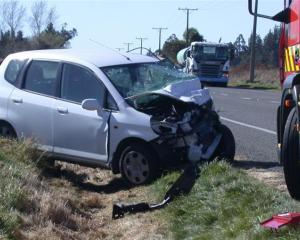 Emergency services attend an accident on State Highway 1, north of Oamaru, in which Allan and...