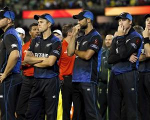 End of the dream . . . New Zealand players watch the presentation ceremony after their loss in...