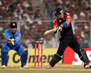 England's Kevin Pietersen plays a shot as India captain MS Dhoni watches during their Twenty20...