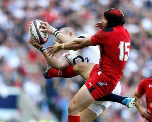 England's Mike Brown (L) challenges Wales' Leigh Halfpenny. REUTERS/Stefan Wermuth
