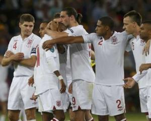 England's players react during the penalty shoot-out.   REUTERS/Eddie Keogh