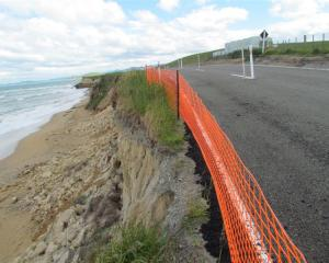 Erosion encroaches on Waianakarua Rd. Photo by Andrew Ashton.
