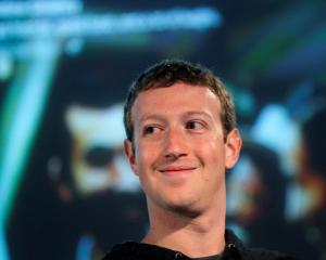 Facebook CEO Mark Zuckerberg listens to a question during a media event at Facebook headquarters...