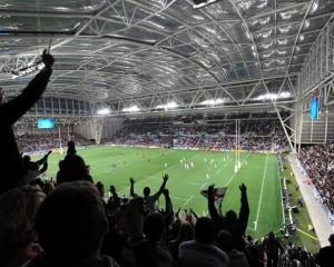 Fans cheer on England and Argentina at a packed Otago Stadium on Saturday night. Photo by Stephen...