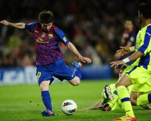 FC Barcelona's Lionel Messi shoots to score against Getafe during a Spanish La Liga match at the...