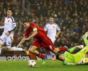 FC Basel's Tomas Vaclik (R) challenges Liverpool's Steven Gerrard during their Champions League...