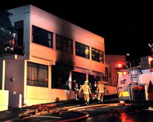 Firefighters break into Kavanagh College in upper York Pl as they fight a fire about 10.30 pm on...