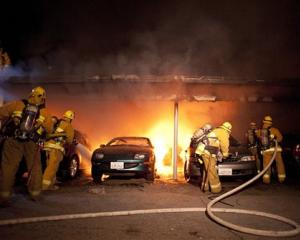 Firefighters tackle a blaze involving numerous cars in the Sherman Oaks neighbourhood of Los...