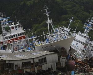 Fishing boats washed ashore by the March 11 earthquake are seen in Kesennuma, Miyagi Prefecture,...