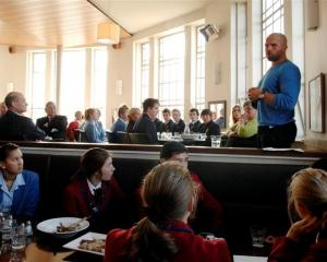 Former All Black captain Anton Oliver talks to secondary school pupils  at the Customhouse Cafe...