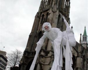 Four-leg stilt walker Rhys Latton practises his spider act ahead of the Midwinter Carnival this...