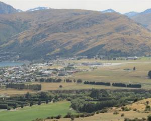 Frankton Flats and Queenstown Airport, as seen from the slope of the Remarkables. Photo by James...