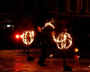 "Freelance performance artist Jeff Robinson lights up the night in ""Firestrom"", a fire and..."