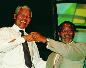 Friends and comrades Nelson Mandela and Oliver Tambo in 1990 in an image from <i>Mandela: In...
