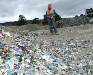 Fulton Hogan Parkburn Quarry supervisor Dave Rogers inspects the stockpile of contaminated glass...