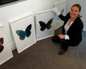 Gallery owner Nadene Milne, of Arrowtown, with limited edition prints by  Damien Hirst. Photo by...
