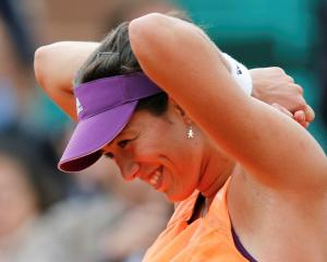 Garbine Muguruza enjoys a moment on her way to victory over Serena Williams. REUTERS/Jean-Paul...