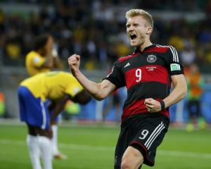 Germany's Andre Schuerrle celebrates scoring his team's sixth goal against Brazil during their...