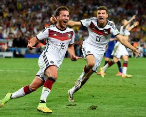Germany's Mario Goetze (L) celebrates near teammate Thomas Mueller after scoring against...