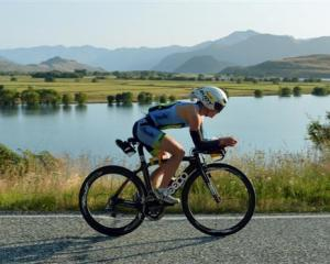 Gina Crawford, of Wanaka, rides  past Paddock Bay on her way to second place  in the Challenge...