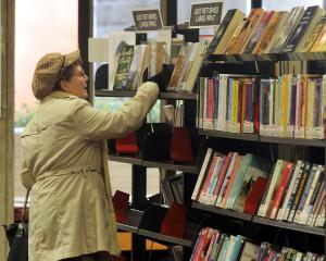 Giselle Steiner, of Dunedin, looks at a book at Dunedin City Library. Photo by Craig Baxter.