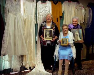 Gladys Morris (85), Nancy Edwards (97) and Noelene Wilson (82) pose with their wedding dresses...