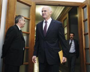 Greek Prime Minister George Papandreou arrives for a cabinet meeting in the Parliament in Athens...