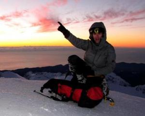 Guy McKinnon on top of Mt Tutoko. Photo supplied.