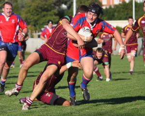 Harbour flanker Hadleigh May is cut down short of the line by Alhambra Union fullback Noah Cooper.