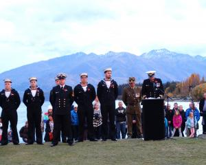 HMNZS Otago executive officer Lieutenant Nathan Vink (RNZN) addresses a crowd of thousands during...