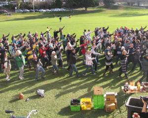Hundreds of NZSki staff and unlucky seasonal workers performed a snow dance at the Queenstown Rec...