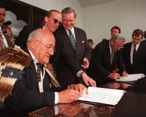 In November 1997, Ngai Tahu claims manager Anake Goodall (third from left) guides  Ngai Tahu...