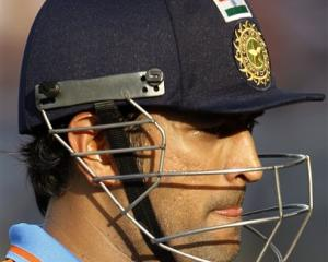 India captain MS Dhoni leaves the ground after losing his wicket during the Cricket World Cup...