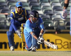 India's Sachin Tendulkar plays a shot off Sri Lanka's Tillakaratne Dilshan during their one-day...