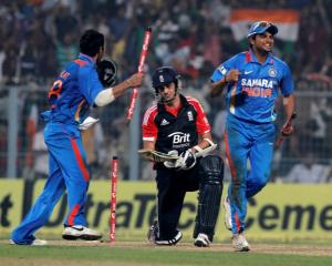 India's Virat Kohli (L) and Suresh Raina celebrate winning the match and series as England's...