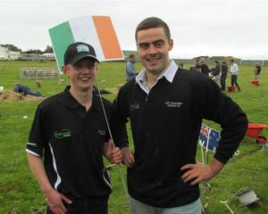 Ireland competitors Graham Murphy and Richie O'Hara raise their flag after completing the...