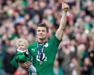 Ireland's Brian O'Driscoll carries his daughter Sadie at the end of their Six Nations match...