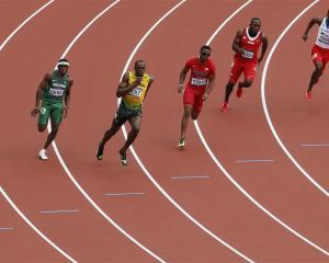 Jamaica's Usain Bolt on his way to winning his men's 200m round 1 heat. REUTERS/Stefan Wermuth