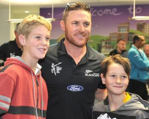 Jared (left, 11) and Thomas (9) Gibson, of Mosgiel, with Black Caps skipper Brendon McCullum  at ...