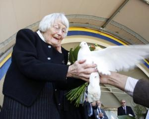Jean Hubbard releases a dove in memory of her late husband, Allan Hubbard, who died in a car...