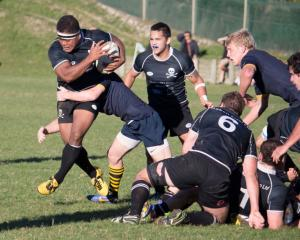Jeke Maiono (Pirates) runs mid air up the edge of the ruck. Photo by Paul Langley