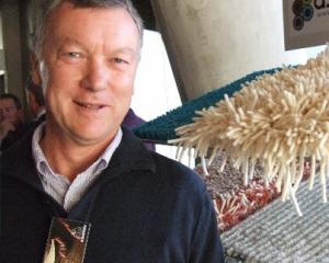 John Grainger with samples of the Ascend Rugs range during the New Zealand Merino Company's...