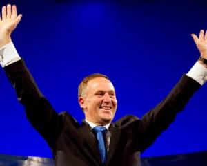 John Key celebrates retaining power after the general election in Auckland. REUTERS/Nigel Marple