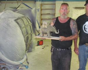 John Rapson (left)and Don Paterson are working on a life-sized replica of an elephant  for the...